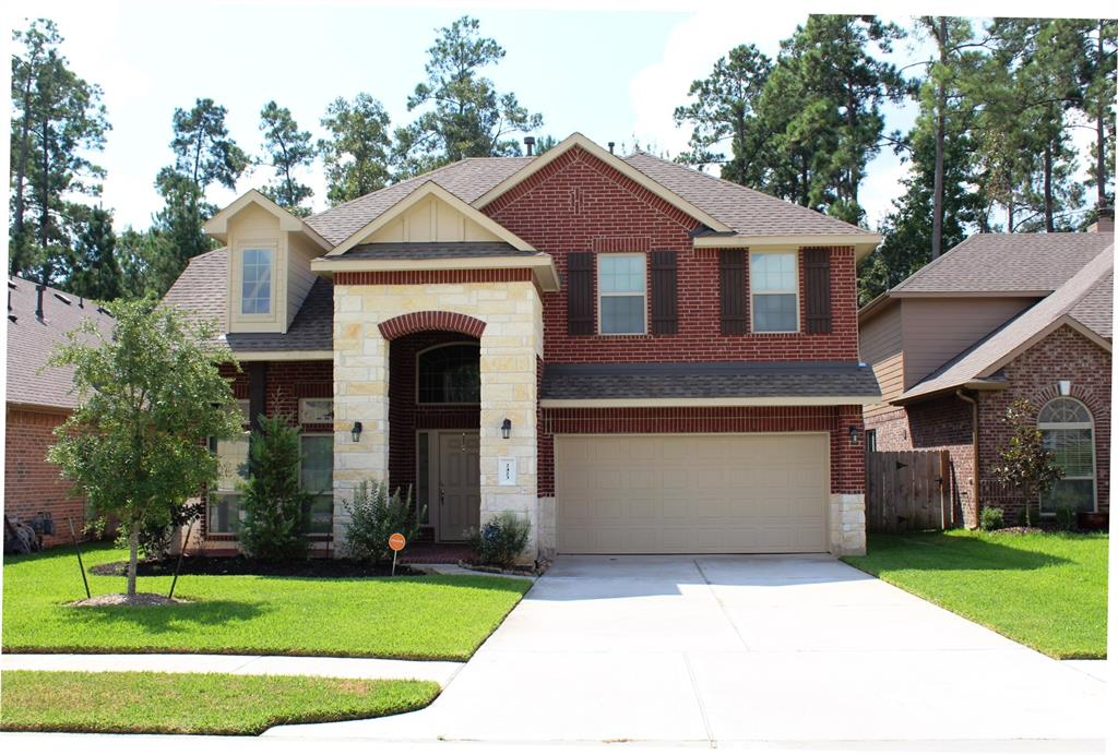 Beautiful Stone and Brick Frontage design and a covered back patio. Minutes from the Woodlands amenities and Woodlands Schools! Granite counter tops with an island Kitchen gas cooktop, stainless steel appliances, wood floors, Double sinks in master bath with a garden tub and shower, Washer Dryer and Refrigerator included! Don't wait too long this one, it won't last long....We are currently planning to begin to show, on Monday the 16th.