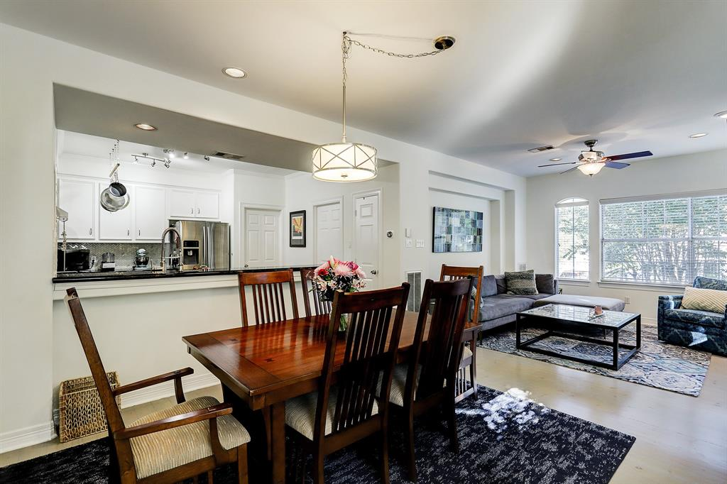 The living/dining/kitchen area is perfectly laid out, with great flow from one space to the next.