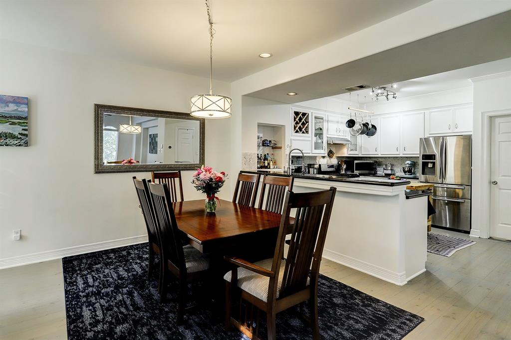 The dining space is generous and could readily accept a bigger dining set up if needed, or add a few stools to the breakfast bar.