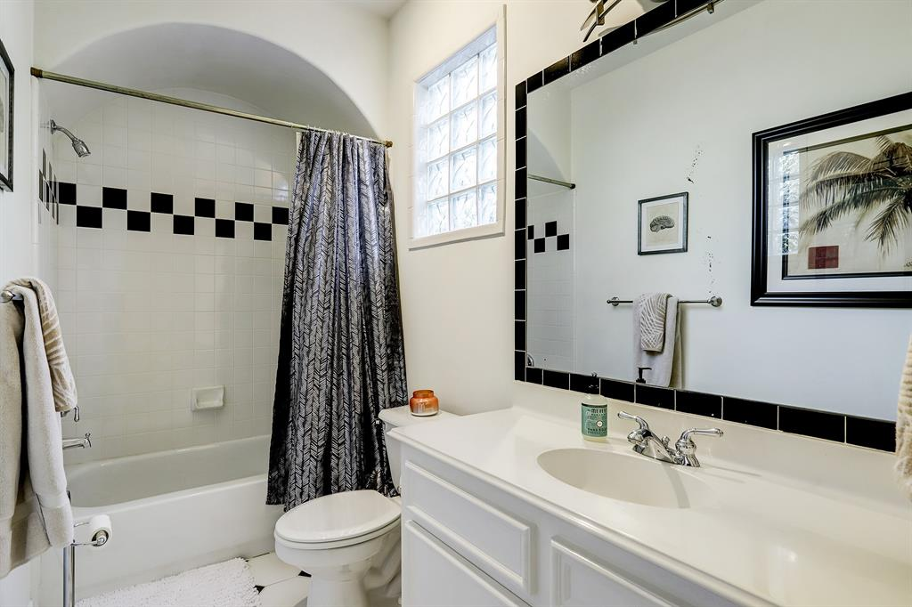 The second full bath attached to the second/guest bedroom has a wide vanity and tub/shower combo.