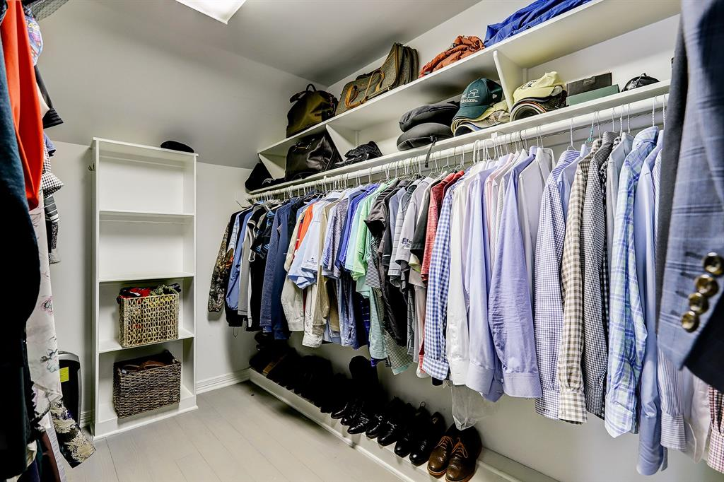 This primary walk-in closet will not disappoint, with exceptional hanging and shelf space.