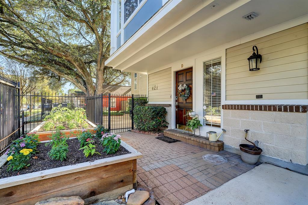 This private courtyard belongs exclusively to Unit D, and is yours to enjoy as you like.  The plant beds were professionally constructed and installed in 2020, and are irrigated.