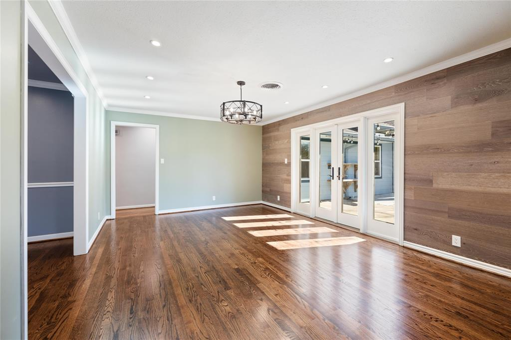Year round the French doors to the patio create a wonderful transition from inside to the back yard. The door at the far end of the room is a secondary access to the bedroom wing.