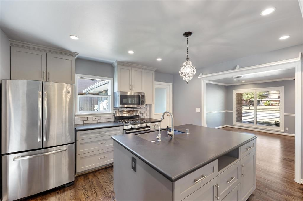 A wide, open door frame keeps the kitchen connected to the living/family room.