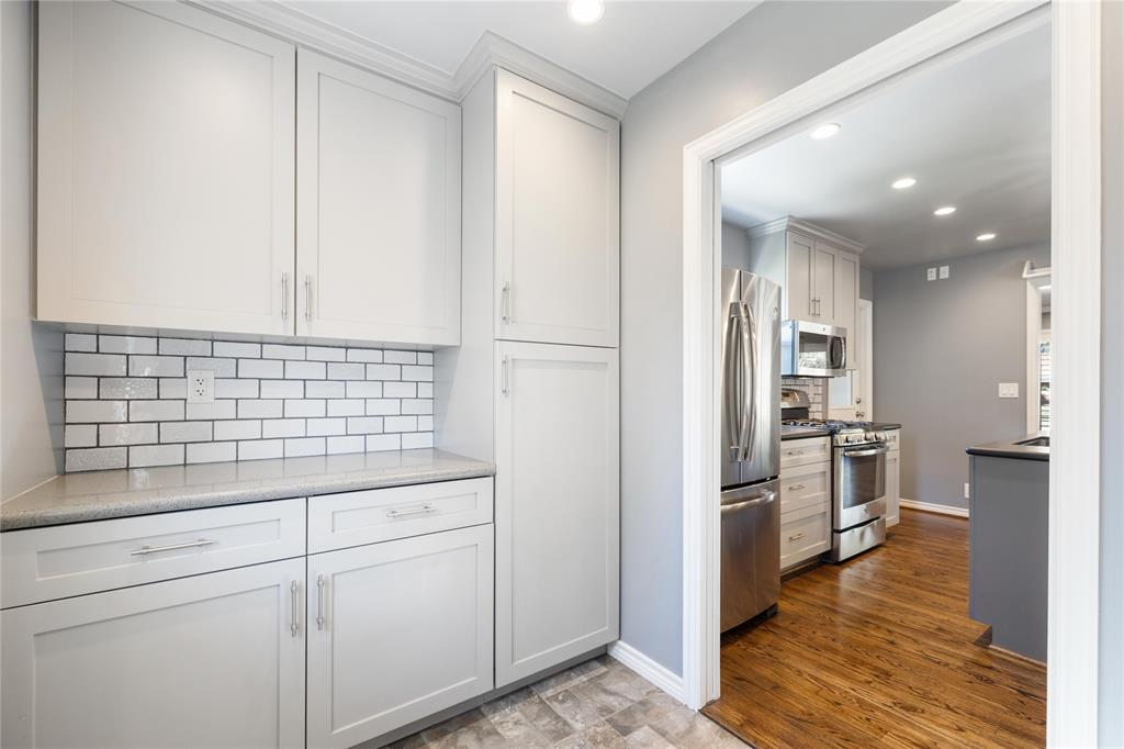 In addition to the cabinet space in the kitchen, measurable storage space is available in the room thoughtfully adjacent to it.