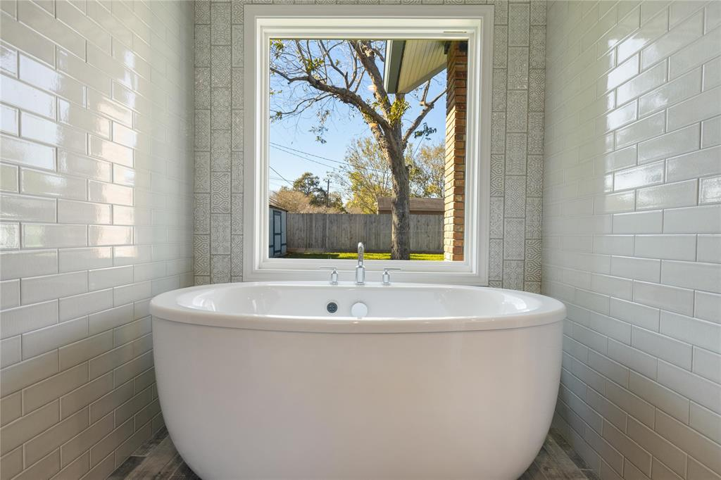 The soaking tub and window to the back yard is a work of art in itself! Get creative with a stained glass piece or top down/bottom up window treatment for privacy.