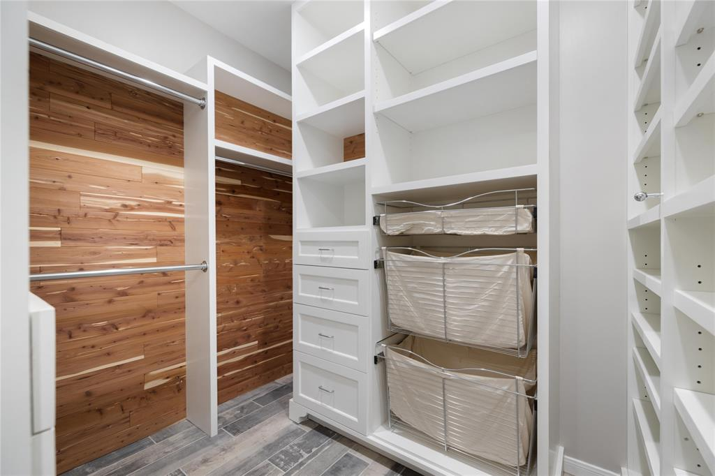 The divided walk-in closet is partially lined with cedar on both sides.