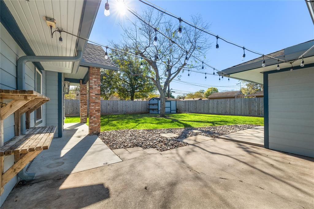 Immediately beyond the French doors of the dining room is a generous patio with room for seating, a dining table, and a grill, smoker, etc. The storage shed at the back of the yard of course stays.