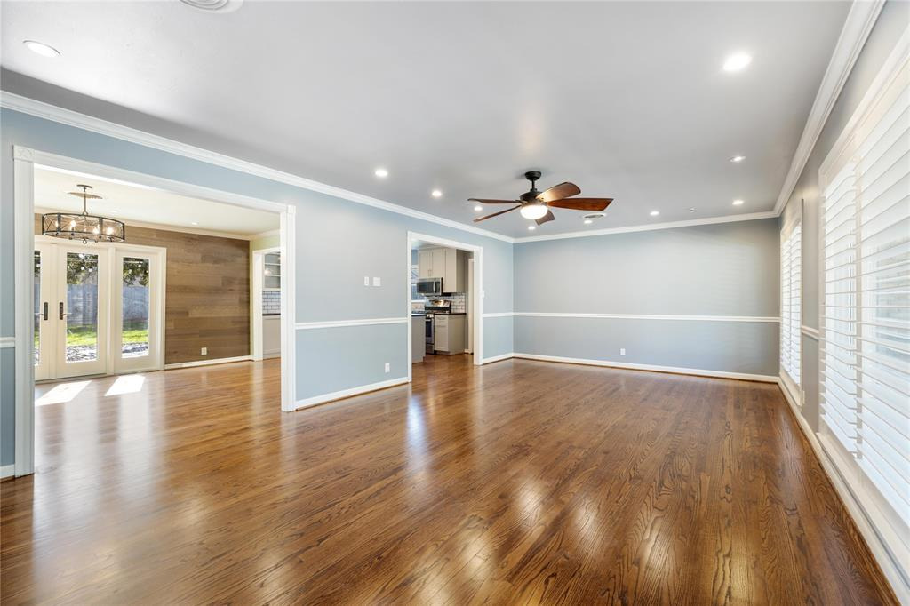 Enter the home to find freshly refinished hardwood floors throughout, and an open floor plan.