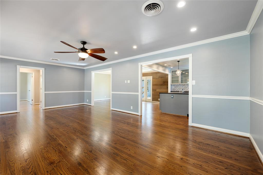 The large living/family room flows seamlessly into the kitchen and dining room.  The hall to the left leads to the bedroom wing.