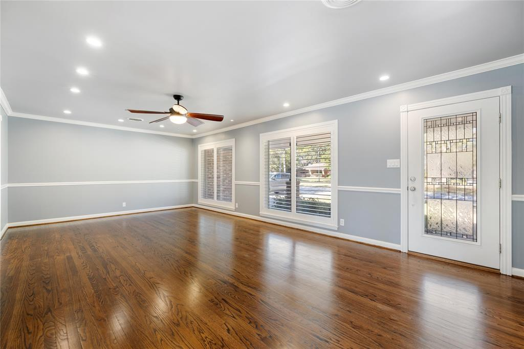 This room will readily accommodate oversized furniture and/or more than one seating area, a game table, etc.