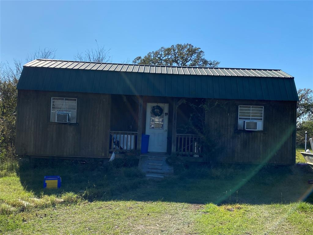 Just 17 miles and 20 minutes from Texas A&M !! This beautiful country property could be your perfect homesite, weekend or gameday getaway!! Pasture with loafing shed, fully fenced, gated entrance and partially wooded. There is a small cabin, a side lofted barn approximately 440 square feet insulated (no sheetrock) with electricity and kitchen sink and bathroom. Would be a great home office or workshop or even a temporary living quarters. There is the beginnings of a barndominium also. The structure is framed for 4-5 bedroom home and needs to be finished. Property has water well, electricity pole close to the barn and septic system.