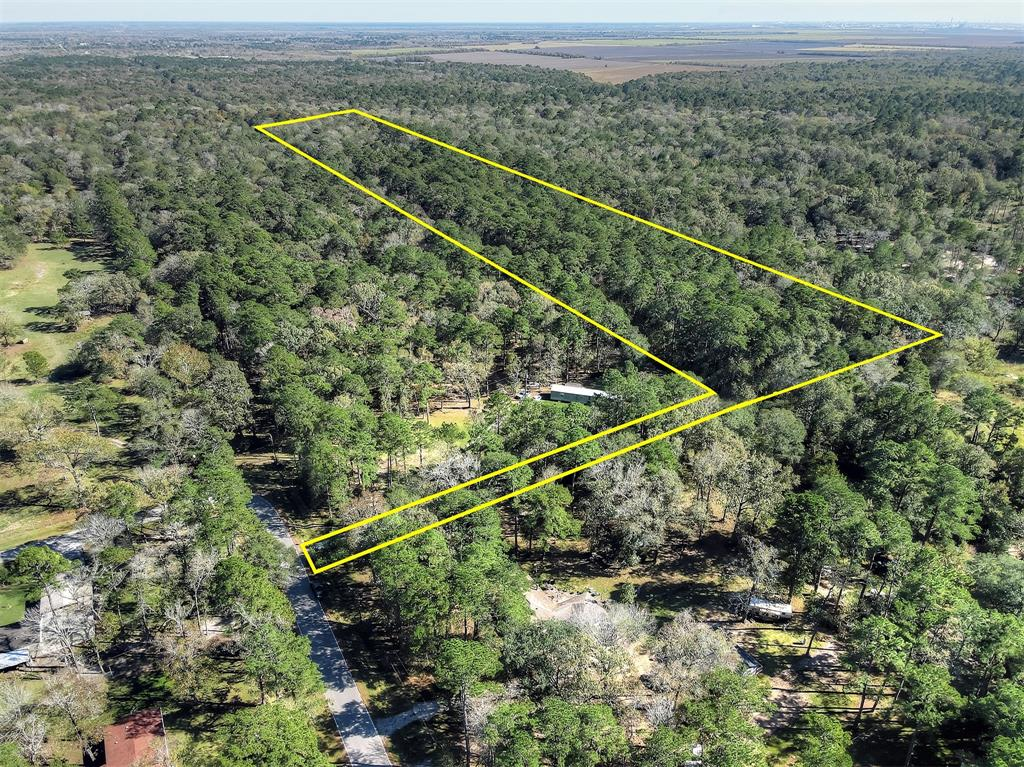 This property is approximately 29.775 acres.  Wooded with some small clearings.  Lots of potential for so many uses.  When you are looking at the for sale sign the easement access is located directly behind it and marked by orange/pink tape.  Follow the easement to the property.  This property does not include any home or building.