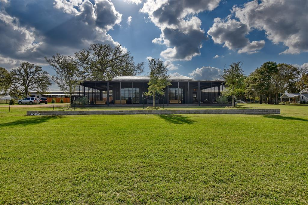 Turn key horse lovers dream! Contemporary farmhouse in Austin County, TX. This rare combination of refined luxury living along side incredible equine facilities. Beautiful renovated residence sits on 31*/- ac. and encompasses open concept living, floor to ceiling window doors, tile floors, custom fixtures, and and gourmet kitchen with top of the line appliances. Complementing the home is the large primary bedroom, closet, gorgeous bath, and spacious screened in porch for every opportunity to enjoy gorgeous views or entertain family and friends. A manicured landscape decorates the exterior and outdoor porch areas. Property features a 1100 sq. ft. guest house, cabin & recreational pond.  Equestrian features include large show barn with indoor arena, 20 stalls, hot & cold wash, tack room and attached lab, 2nd show barn w/ 10 stalls, and a certified stallion breeding facility. Both barns detail craftmanship and superior stall equipment mix safety & luxury together. Property details att.