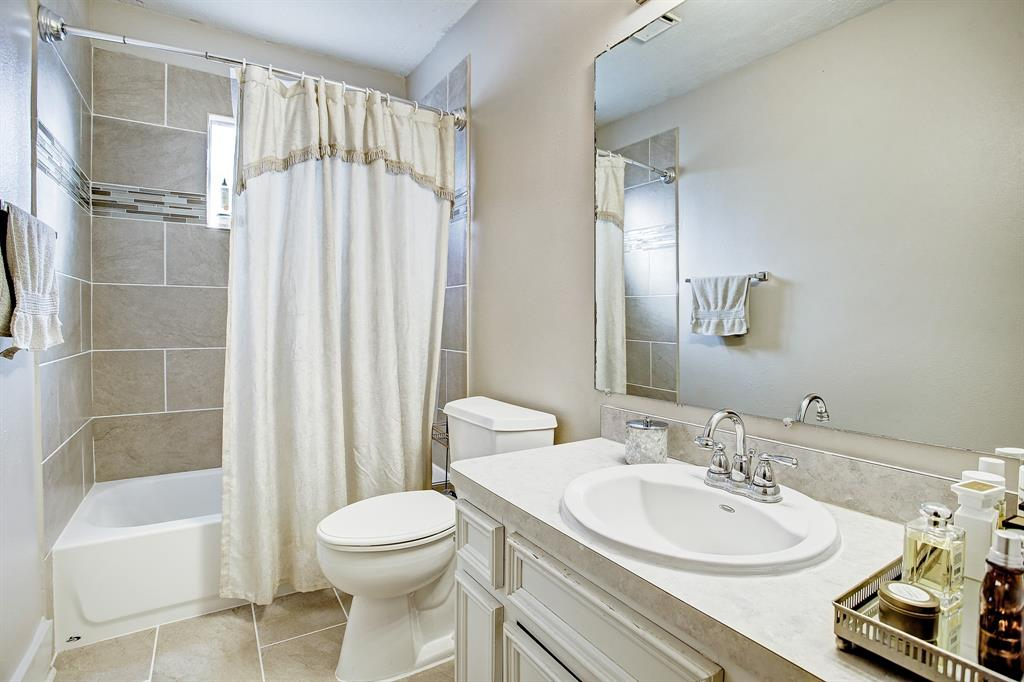 This full bath is private to the primary suite. The tub, shower surround and floor are brand new!