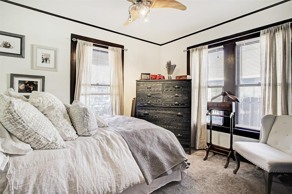 The second bedroom sits at the front of the home and overlooks the porch and front yard. It has plenty of space for a queen bed, dresser and chair, and of course has its own closet.