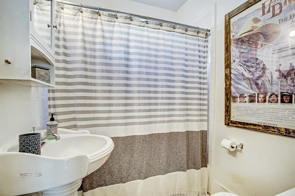 The second full bath sits between the bedrooms in the hall off the living area. It is also a shower/tub combo.