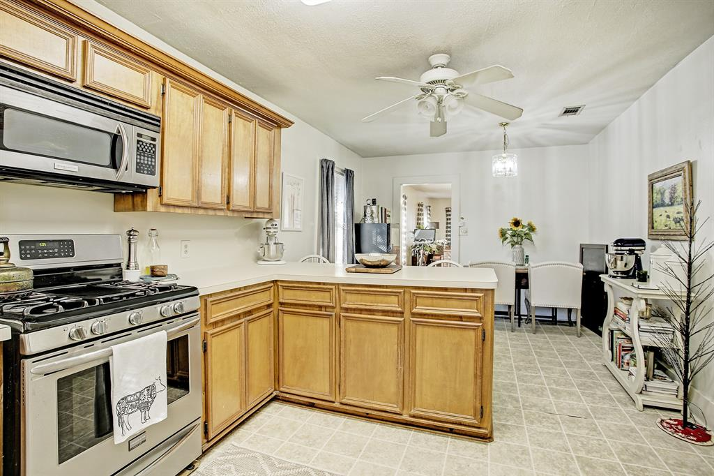 The kitchen has stainless steel appliances including a gas stove, as well as lots of cabinet and counter space.