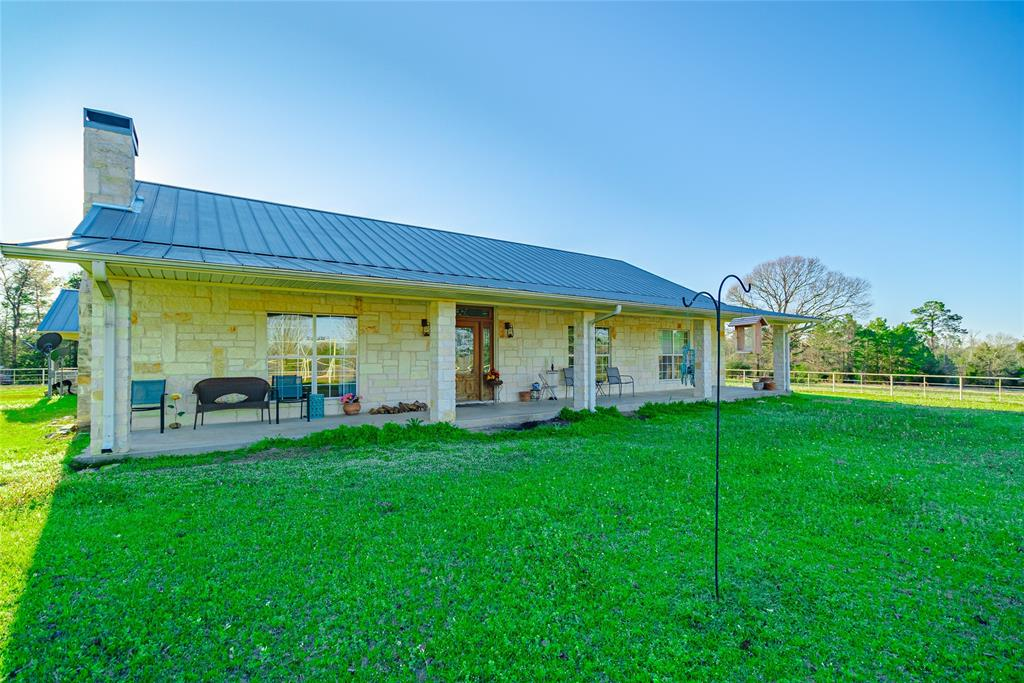 This pristine 47-acre property located in Anderson County, just 2 miles from HWY 287, was masterfully designed to be the ultimate rancher's paradise. The property boasts amenities such as an oversized 36'x64' barn, pipe fencing & corrals, a FULLY STOCKED .47-acre pond, a spring-fed creek that runs from the pond down the length of the property year round, a chicken coup, and a 3/4-acre paddock that can be used for barrel racing, roping, corralling, and more! Property has 24 cleared acres + 23 wooded, and includes 2 main pastures that are cross fenced with water on both sides. The home is secluded toward the rear of the property allowing for the utmost privacy, and features massive covered porches with views of all 47 acres, soaring high-ceilings, a floor-to-ceiling wood-burning stone fireplace with a wood mantle complimented by matching built-ins, and spacious bedrooms! This country paradise is perfect for a weekend getaway home, as well as a primary residence! Schedule a showing today.