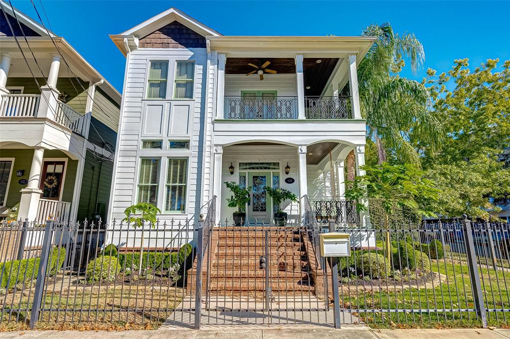 Elegant Victorian home in Houston's sought-after Height's. This Heights home was completed in 2006, with twin wrap around porches, a private rear balcony and a garage apartment/studio/detached office. Enjoy extensive modern and luxurious architectural character steps away from shops, entertainment, local dinning and various boutique fitness options. Upon entering, eyes are met with rays of natural lighting and an elegant staircase, with a beautiful stained-glass window that accentuates the gentle mix of Victorian features. Wall to wall crown molding and oak floors throughout. Recently remodeled gourmet kitchen has built-in SS Thermador refrigerator and appliances. No detail was spared with the wet bar and quartz island. Master bath is glorious, with dual vanity, lots of built-in storage, a chandelier over the bath and oversized shower.  ***Excludes Dinning chandelier and half bath mirror.***