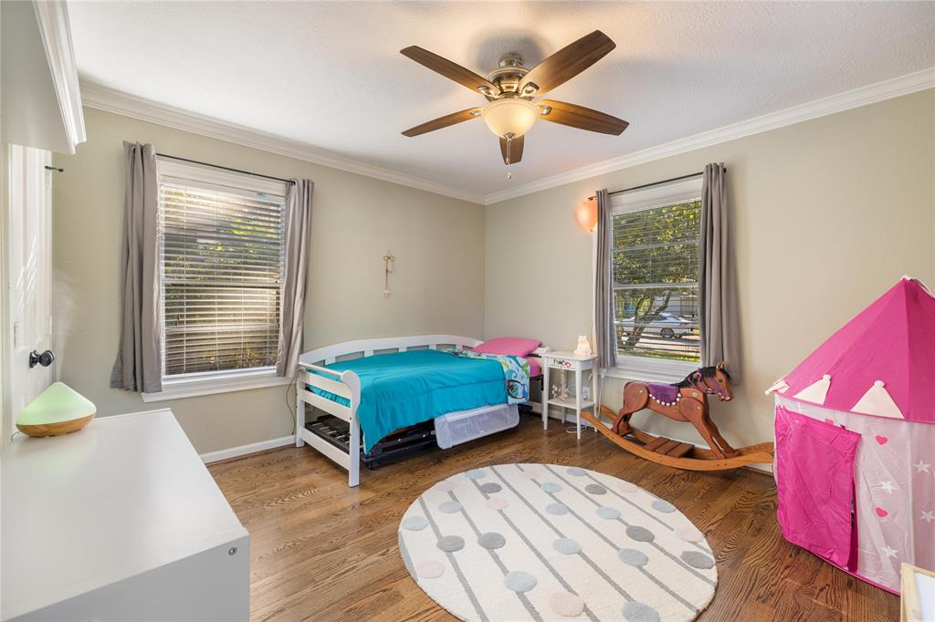 Another generous sized bedroom with crown molding and hardwood floors.