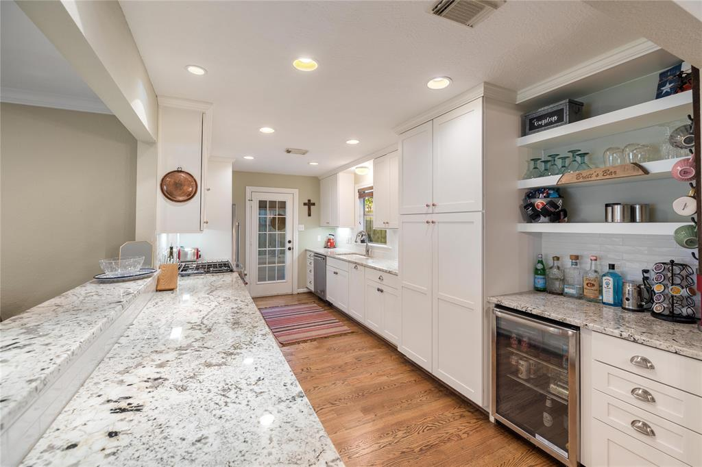 The remodeled kitchen offers tons of cabinet and counter space. The dry bar includes a beverage fridge and plenty of storage as well.
