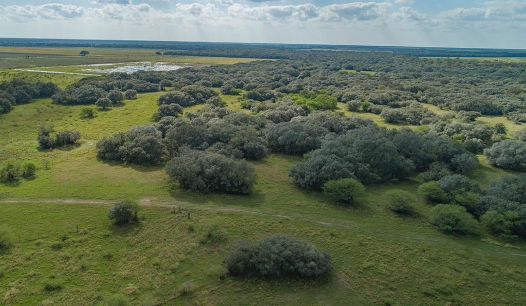 "1281 +\- contiguous acres of multi-use property 80 miles sw of Houston. Aprx 2.5 miles of road frontage on CR 360. Great investment property w/history of rice farming, currently being grazed. Wharton co. is a top rice farming county in Tx. IDEAL FOR WATERFOWL AND MIGRATORY BIRD HUNTING OPPORTUNITIES! Abundant whitetail deer*dove* hogs*bobcat*varmints*turkey*quail. Beautiful Oaks and other native trees follow the meandering Porter Creek that flows through the property. 1/3 of the property is brush/timber, great for deer hunting. 2700sf metal building w/375sf living. 12 & 8""  discharge irrig. wells*2 dom. wells*stock pens*1 +/- mile recently replaced exterior barbed wire fence & other existing fencing that is in fair to good condition*5 duck ponds*2 creek crossings*underground irrigation pipe*crop base*permit for 200 acre foot of water from creek, 533 acres grazing lease. No commitments on the property other than grazing lease. 2 pipeline easements. Mostly Edna and sandy loam soils."
