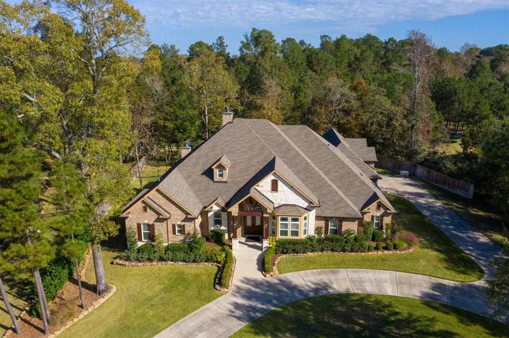 One of a kind,custom estate located on a cul-de-sac,1acre+ lot in Ridgelake Shores w/heated pool & spa.Meticulously maintained w/every detail carefully designed.Solid Mahogany double front doors, tile & wood like tile floors thruout most of home.Lives as a one story w/a flex/game/bedrm up.Endless amounts of storage!Private study w/formal dining/second study.Gourmet kit is a Chef's Dream w/DCS Chef quality natural gas 6 burner range &  dbl ovens.Exquisite cabinetry,top of the line granite,two sinks,spice racks & more!Primary bedrm down w/sitting area.Incredible primary bath w/dbl entry walk in shower & dual shower heads!Jetted tub w/inline water heater sys & air cycle.All sec bedrms generously sized w/great closets!Enourmous covered back patio!Screened in outdoor kit makes grilling a breeze!3 car garage w/epoxy coating & sep workshop.Whole house generator & dehumidifier!Tankless H20 heater,water softener & purifier!TX basement & so much more!Please see docs for full list of upgrades.