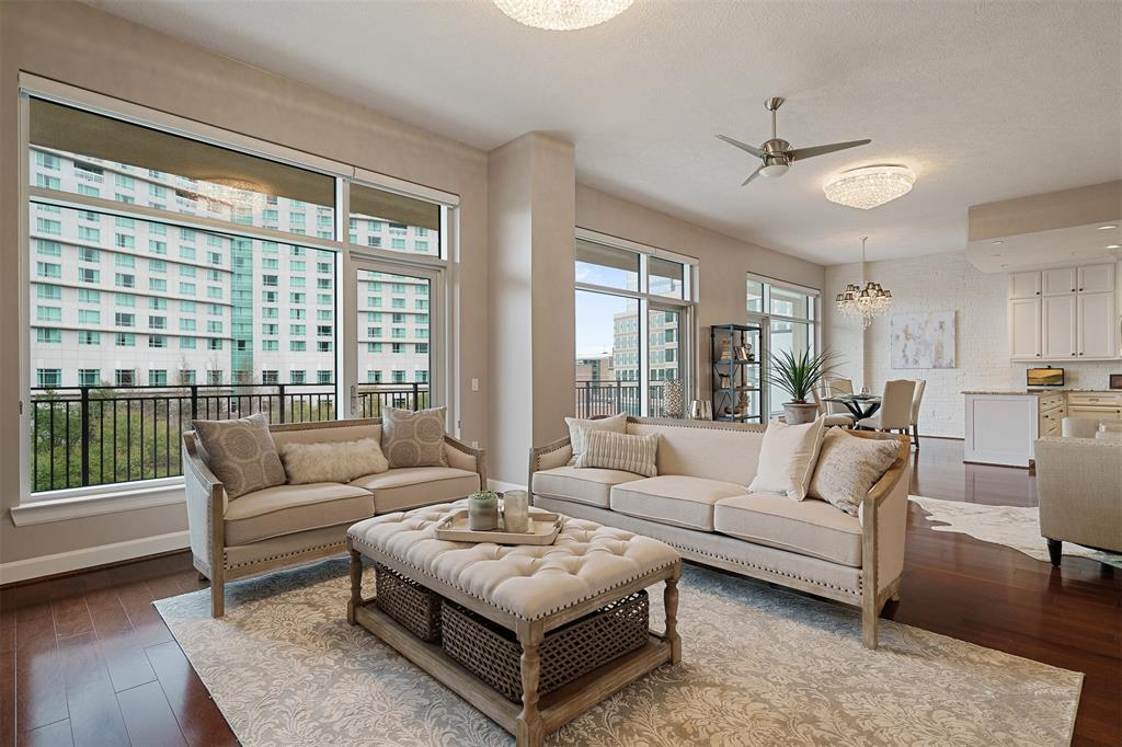 Spectacular 4th floor unit w/ dazzling views of The Woodlands Waterway & Skyline! Perfect space for an executive or who wants lock and go living but desires a high end lifestyle! Walk able to all the best restaurants & entertainment that The Woodlands has to offer including concerts at the Cynthia Woods Mitchell Pavilion. Loft has an open concept w/walls of windows opening out to the 42 feet of balcony which provides amazing views from every direction. Hardwood floors, open island kitchen, SS appliances, wine refrigerator, space for ice maker. Grand living area w/closet housing a Murphy bed for the occasional guest. Master suite w/oversized closet, executive bath w/walk in shower, whirlpool tub & access to hallway for guest. Private storage unit, 2 assigned parking spaces, key fob access, pool, grilling area, party room/meeting space, direct access to the miles of waterway paths great for walking or biking and a peaceful Zen Garden w/Koi pond fronts the building.