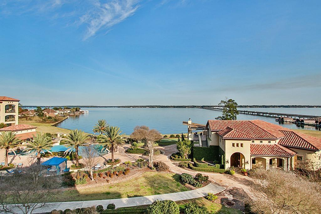Remarkable lakefront community offering endless lakeside adventures surrounded by a lush, tropical landscaping, exquisite style w/ambiance of a Spanish resort. This 4 bedroom 4 bath unit has high ceiling tile flooring in kitchen and living area, granite countertops, and large balcony with great view of Lake Conroe! Amenities include a private clubhouse w/ billiards room, gym, entertainment room & bar infinity edge pool, hot tub, cabana seating & lounge areas, fire-pit, summer kitchen, putting green, courtesy dock & so much more! Schedule your private tour today!