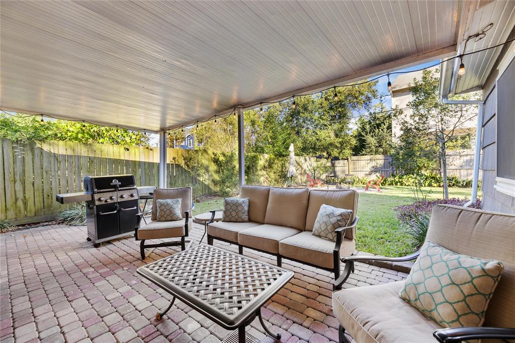 This large covered patio offers a great space for entertaining and relaxing in the afternoon.