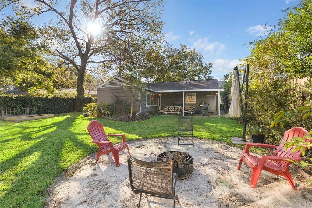 Backyard also includes a fire pit area and outdoor garden.