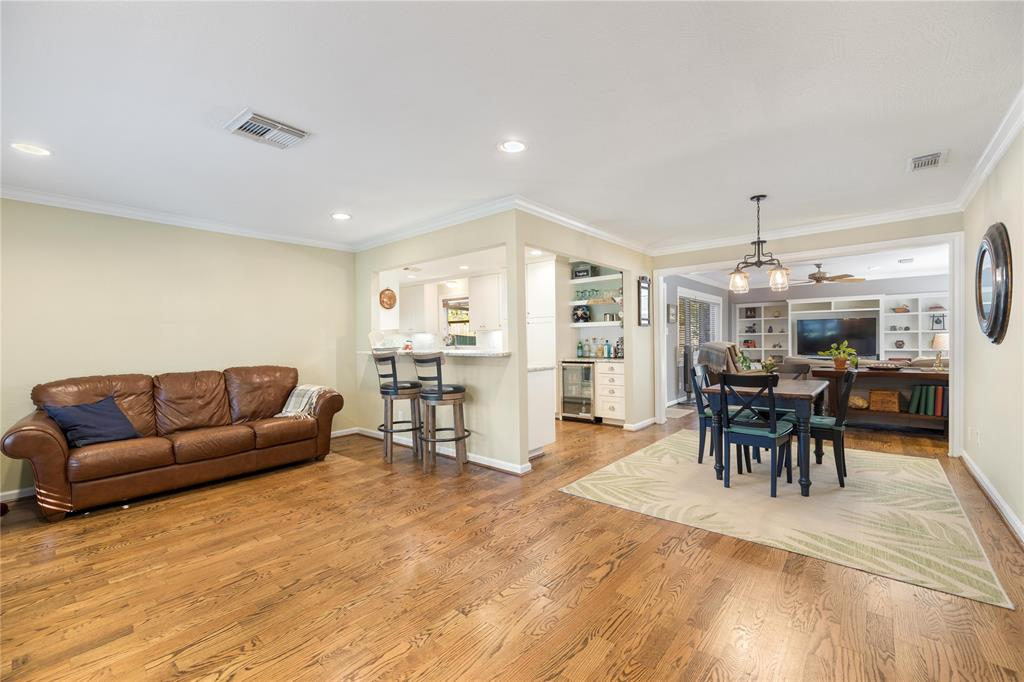The open floor plan is a great space for entertaining. You're going to love the classic hardwood floors, crown molding, and recessed lighting throughout this home.