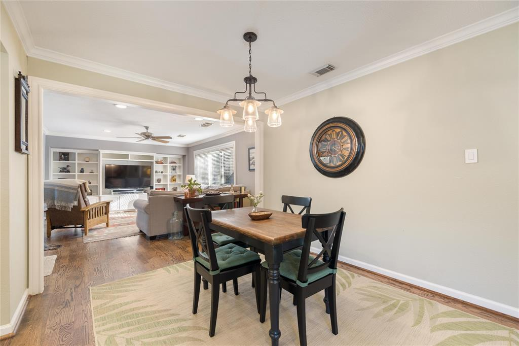 The dining room space is located off both the kitchen and the living room.