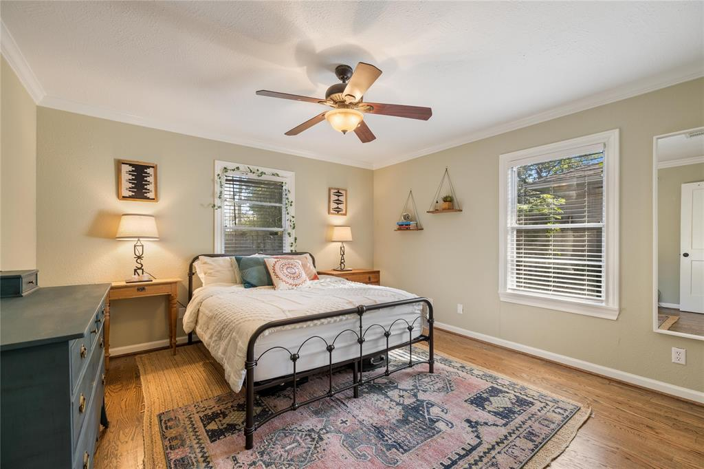 The large master bedroom includes hardwood floors, crown molding, and generous closet space.