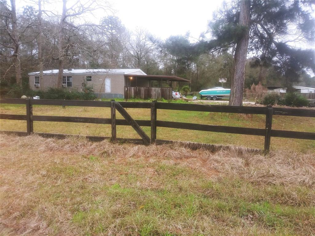 Only one mile from I-59 .  Fronts FM 3460,  runs length of Prater.  There is a private road along the length of Property. Surrounded by forest on both sides.  Formerly a horse training facility.  Center isle stable has 8 stalls w/ covered riding area, tack room, hen house, runs for each stall, and a metal hay storage barn. Unrestricted. High and dry. Not in the flood plain. Two ponds,  two septic systems, fenced and cross fenced. Many possible uses.  Waiting for your personal touches.