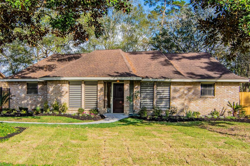 This beautiful French style home is located across from the golf course in the front, and an open pasture view in the back. Home totally renovated from front to back. Beautiful kitchen with white cabinets and quartz counter tops. Spacious living area with custom stone