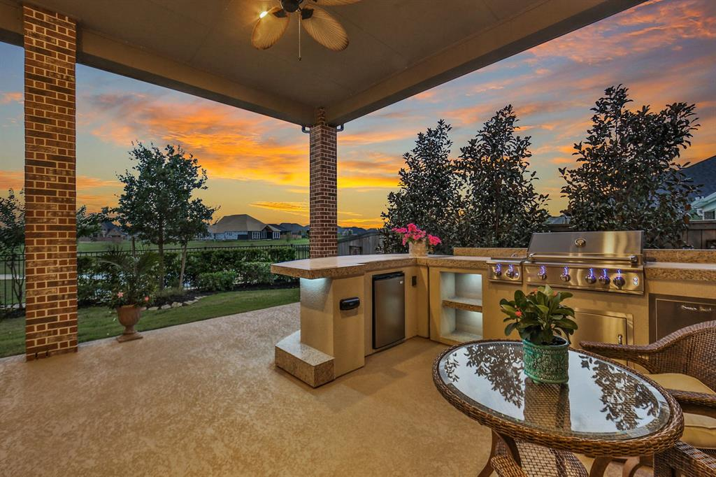 Welcome home to a corner water view homesite in the sought after community of Veranda! This stunning 1-story Perry home features 4 bedrooms, 3.5 baths & a 3 car garage! As you enter you are welcomed by an impressive arched entryway with 14' ceilings & a large study! This home offers the perfect open layout for entertaining! The kitchen is a chef's dream with oversized island, wrap-around bar seating, 5-burner gas cooktop & stainless appliances! The family room showcases high ceilings, fireplace & large windows providing picturesque views of the outdoor living area & lush landscaping! Relax & watch the evening sunsets on the oversized covered patio with custom outdoor kitchen! Private game room & separate dining are conveniently located off the kitchen & family room! This home has it all & features custom light fixtures, a whole home water softener & reverse osmosis system. Veranda's award winning amenities include a resort style pool, recreation/fitness center & picturesque trails!