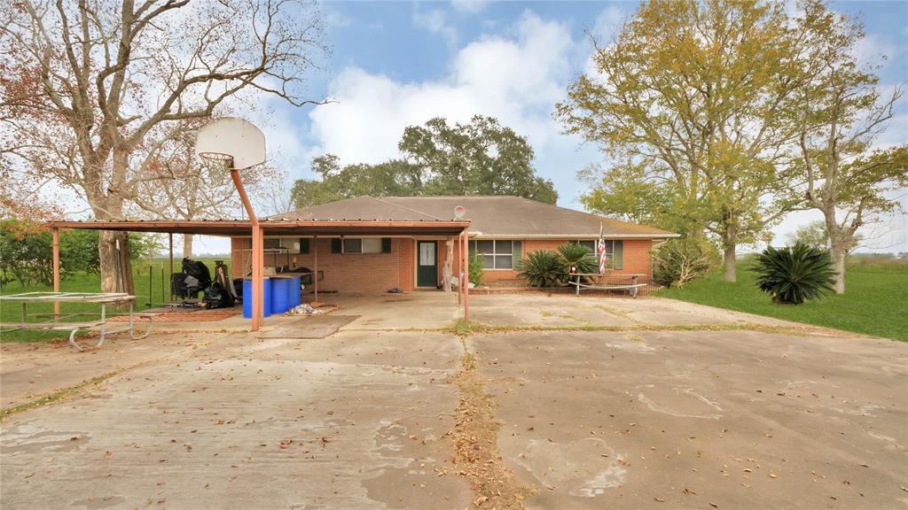 Tons of potential in this fantastic single-story home on 3 acres in the quiet country town of Orchard, TX. Large kitchen with tons of counter space and a large eat in area that could easily double as a formal dining room. 4 bedrooms and two large living areas. Second living area opens to a large covered porch with french doors leading out to a fenced private yard within the 3 acre property. Separate guest house or home office just off the covered patio with a full bathroom and separate entrance. Large laundry room and secondary utility room inside the home. Pool in the back is empty, does not work, and it is unlikely it will be able to be fixed. Two secondary buildings on the property - one could easily be made into a workshop. Roof needs work. Listed home SF does not include the converted garage. Attached carport in the front of the home. Survey in hand lists the property at 3.566 acres. This home is listed as-is; Seller will do no repairs.