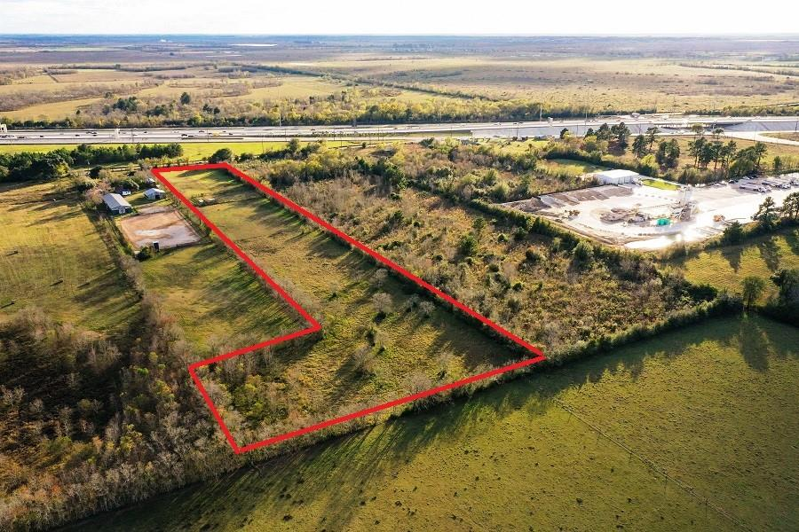 """Prime location along the rapidly developing Hwy 290 corridor. Perfect commercial location with excellent visibility from US Hwy 290. Located approximately 2.5 miles from the Grand Pkwy & approximately 2.5 miles from the Daikin Technology Complex. Unrestricted, no zoning, no flood plain & cleared. 177 ft. frontage on Zube Rd. The property is in the shape of a backwards """"7"""" with rear measurement of 334 ft. (see survey). A great opportunity with many possibilities!!"""