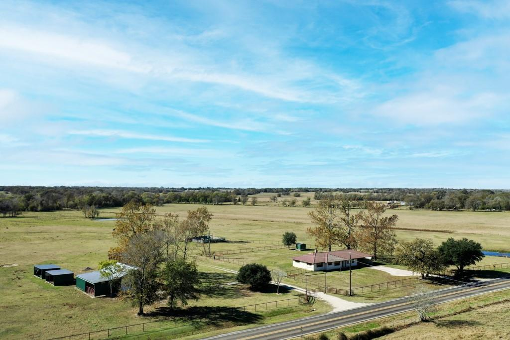 The 978 Ranch is a 125 +/- Acre working ranch that will suit all of your agriculture and hunting needs.  Featuring high visibility with 2300+ feet of paved road frontage with pipe fencing, perimeter and cross fence; 30x40 workshop, RV hookup, multiple sheds, working pens, a large pond, 2 stock tanks, and a creek branch.  Presently used for cattle and hunting, this recreational property presents approximately 70% open, 30% wooded with fertilized fields of planted coastal mixed with native Bahia grass having sandy and clay loam soils.  Several hard and soft woods allow coverage and forage for cattle and the abundant wildlife on this beautiful property.  The rustic farmhouse has 2,171 SF (CAD) of living space and was completely remodeled down to the studs in 2016 this 3 bedroom, 3 full bath home displays an open concept kitchen/dining/living areas, granite counter tops, walk in pantry and large laundry/mudroom.  Located 3 miles from Madisonville and just outside of Bryan/College Station.