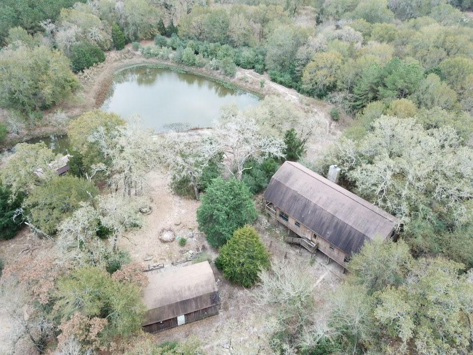 Property surrounded by 8ft game fence. If you open gate to enter be sure to close.  Donkey and Shetland pony on property. Run off pond.  Deer feeder.  Utility shed. Storage shed. Guest house.