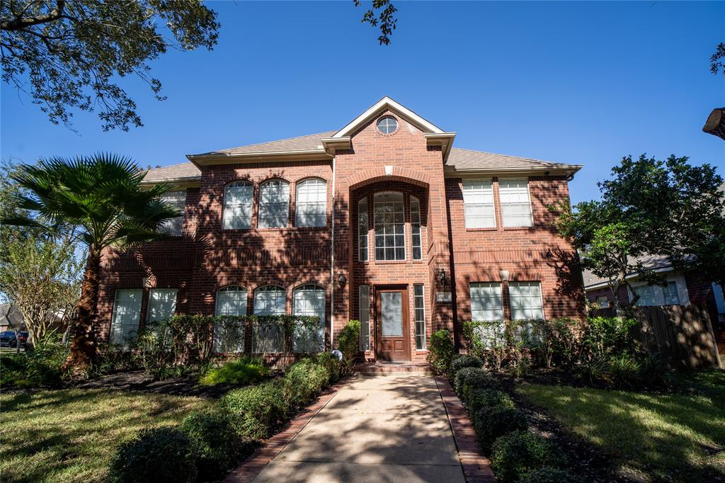 Welcome to this gorgeous home located in the NEW TERRITORY. This home sits on a 10,533 sqft LOT!! This 2 story home includes 5 beds/4 baths and high ceiling throughout. The beautiful and updated kitchen opens up to the living room. Granite countertop and tile in the kitchen, with brand new cabinets!! Stand-up showers in every bathroom! The primary bathroom has double sink vanities, huge tub and a shower. His and hers closets connecting to the primary bathroom. Wood floor and tile throughout the house! Backyard has an outdoor kitchen which is perfect to entertain family and friends. Conveniently located close to US 59, Hwy 90 and Grand Pkwy 99, highly desired Fort Bend ISD. Community facilities include Club Gymnasium, Fitness Center, 4 community pools, soccer and baseball fields.  NEVER FLOODED!!! Schedule a showing today!