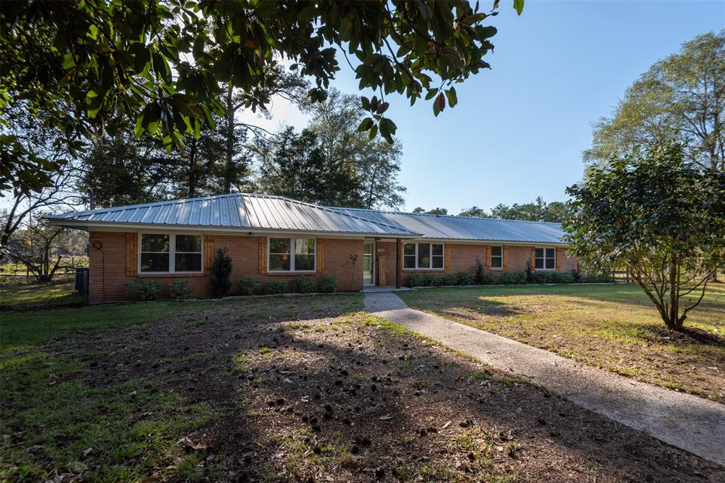 Completely Updated 4 bedroom 2.5 bath on 40 acres. This beautifully completely renovated home features brand new oversized primary suite with custom bath and closet. You will not want to miss the primary retreat! Off the primary you will find the large mudroom/laundry with custom cabinets, freezer/fridge space, and loads of storage space. The brand new kitchen overlooking the back patio and pasture will not disappoint. The custom cabinets, granite countertops, new Kitchen Aid appliances, and open concept to the Dining room will making cooking a breeze. You will find molding around windows and doors to keep the charm of the home a live. The split floor plan is prefect for kids or guest. The two additional bedrooms with large closets and a second primary bedroom/guest suit with half bath. This property offers open pastures for cows or horses, barn, garage, shed, chicken coop, duck coop, and fully stocked ponds will not disappoint. There is even an elevated deer stand waiting for you!