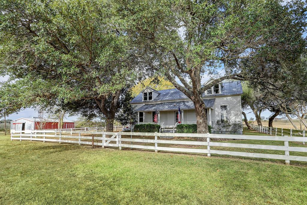 Rare opportunity to purchase 105 beautiful acres of rolling hills with live oaks that have been in one family for over 50 years. The history of the ranch dates to the original Stephen F. Austin 1825 land grant. The charming cottage is over 100 yrs. old and a shiplap lover's dream with wood floors, high ceilings, large front porch, awaiting restoration that will be the envy of Chip and Joanna Gaines. 3 bedrooms, formal living, dining and eat-in kitchen. Numerous other scenic hilltop home sites with clusters of live oaks. 2 ponds, nice mix of open pastures and wooded areas. Horse Barn with 5 stalls, tack and feed rooms. Old barn protects a one-room log structure that would predate the house. Great antique wood for future projects. Ag tax exemption in place. Minutes from the cute town of Burton with great dining options. Only 15 minutes to Round Top and Brenham for more restaurants and shopping. Conveniently located halfway between Houston and Austin and 47 mi from Texas A&M.