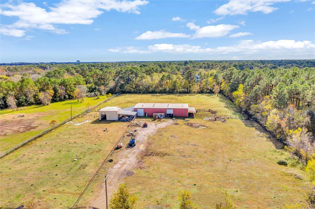 5 acres of fully fenced and cleared land within the city of Dickinson.  Contains 1300 sqft meat processing building with central air/heat, full bathroom, on city water and sewer (meat processing equipment negotiable).   50 x 100 commercial barn with 4 pens for livestock, 3 bays (2) 12x12 (1) 8x10.  50 x 100 cattle shoot made of 13cr pipe. Wastewater lift station, 2 stage dual pumps, capable of supporting two homes.  Property has been filled and, per owner, does not hold water and did not flood during Harvey.