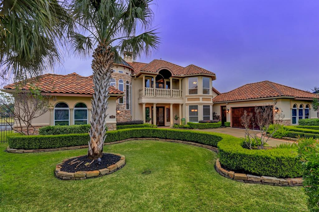 This magnificent property, in a private gated community, is unlike any other zoned to KISD. Resort style views from every angle of this gorgeous Mediterranean jewel. Almost a half acre to enjoy, located on a cul-de-sac, top of the line attributes including a negative edge swimming pool with fountains and hot tub that overlook the lake, spacious rooms with huge walk in closets and balcony views, a master retreat with decorative lighting, whirlpool, oversized shower, attached study, his & her closets with upgraded storage systems. Enjoy custom cabinetry and lighting, a private boat dock, a massive mud room with expansive cabinetry, open kitchen with breakfast bar, a remarkable amount of storage space, surround sound system, elegant hardwood flooring, gameroom balcony, 3 car epoxy floored garage with updated smart garage equipment. Walking distance to Exemplary rated schools. Quick drive to La Centerra Shopping, local supermarkets, Alamo Drafthouse Cinema! Don't miss online virtual tour!