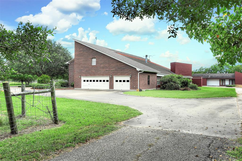 Don't miss out on the opportunity to own this wonderful custom home situated on almost 18 acres just minutes from Bay City! The unique floorplan is perfect for entertaining, boasting a huge kitchen, elegant formal sitting and dining areas, cozy wood panelled library, media room, spacious game room and seven bedrooms. Upon entering the home you're greeted with a showstopping curved staircase and fresh grey paint. Upstairs, expansive windows and the huge second-story patio provides serene views of the stocked pond and pastures. Outdoor fun is sure to be had with the basketball court, tennis court and in-ground pool. The home also offers a private pool house which guests will love. An oversized three car garage and and tons of decked attic space make storage a breeze. Pristine country living!