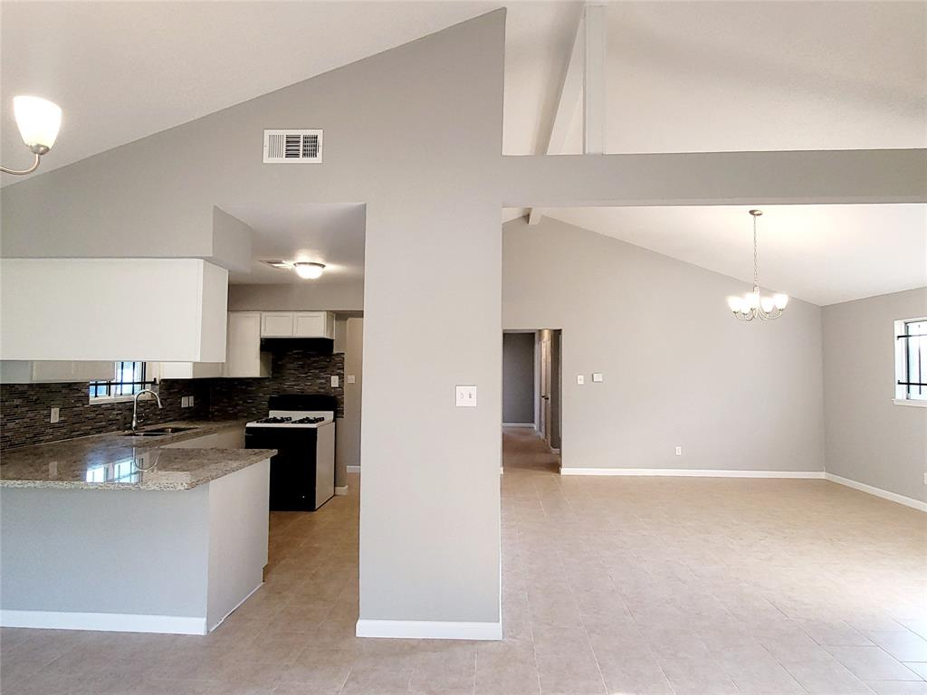 Newly renovated and ready to move in, with a high ceiling. New A/C unit, new flooring, new paint, new cabinets, and granite countertops in the kitchen and the bathrooms. Long driveway and big backyard.  You need to see this house to appreciate it.
