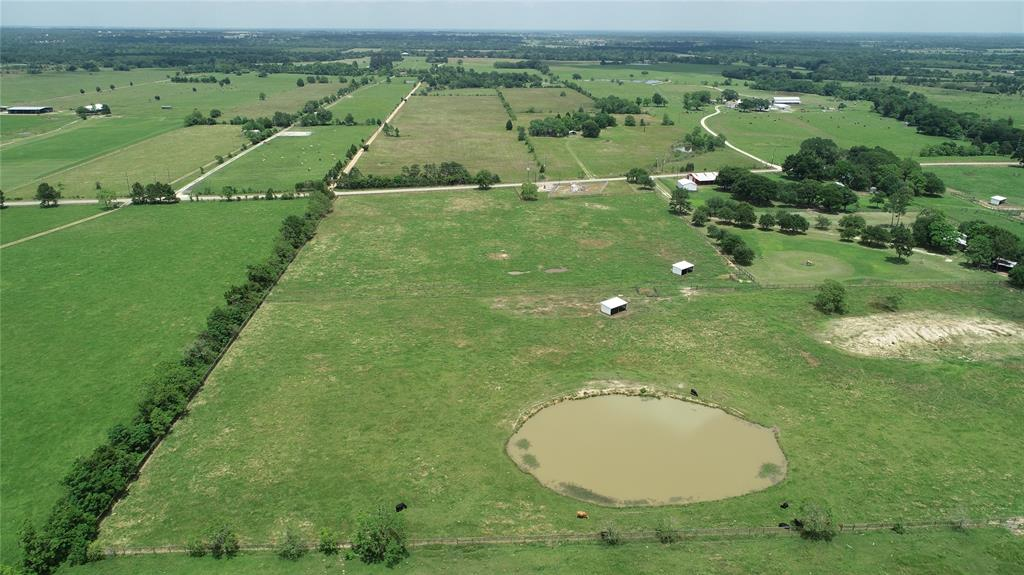 13+ Acres with POND, homesite. No mobile homes  Paved road frontage, fencing and deep pond that never went dry during the drought...nice building site.  Well suited for cattle, horses, or other livestock. Sandy soils, good drainage, NO FLOODING.  Current agricultural exemption on property taxes  Public water is available, Reliant Energy available for electricity, septic system will be required.  Property does have a pipeline also a measuring station on one corner of road frontage.    So convenient! Just west of Houston/Katy. 10 minutes to Interstate 10, 25 minutes to Grand Parkway 99.
